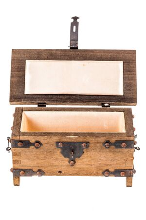 coffer: an ancient wooden medieval coffer isolated over a white background