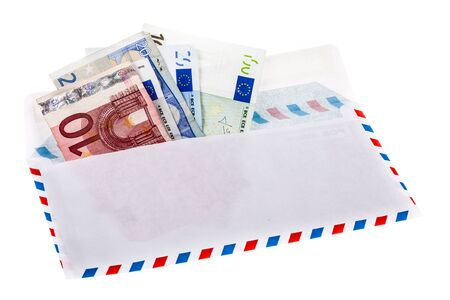 inadequate: an air mail envelope filled with money  isolated over a white background Stock Photo