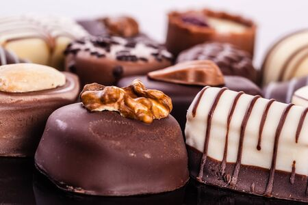 patisserie: close up shot of an assortment of delicious chocolate pralines with different shapes