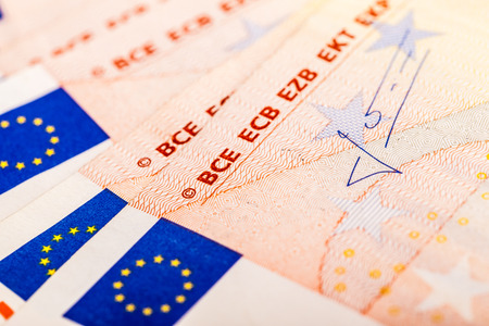 bce: detail of some 50 euro banknotes with the flag of the european union