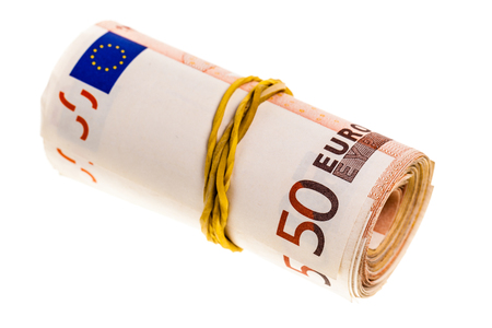 a roll of 50 euro banknotes isolated over a white background Stock Photo