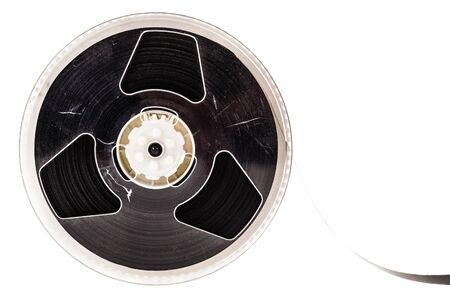 an old magnetic tape reel isolated over a white background