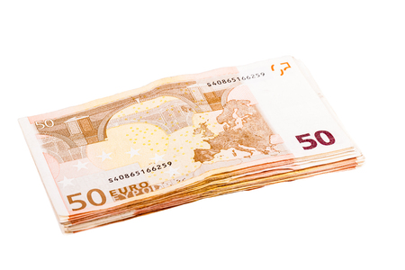 50 euro: a bundle of 50 euro banknotes isolated over a white background