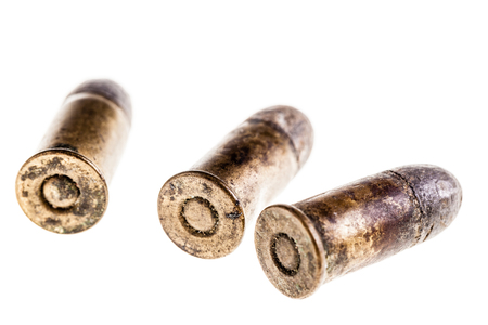 macro shot of an old rusty bullet isolated over a white background Stock Photo