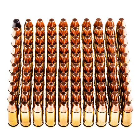 geometrically: a lot of 9mm handgun bullets geometrically placed in rows isolated over a white background