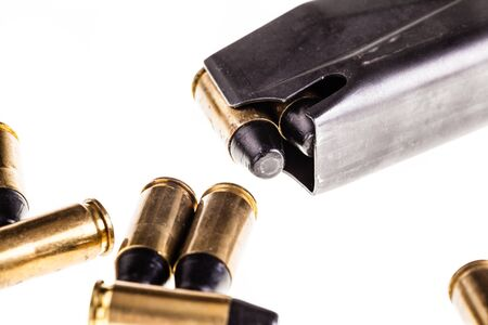 9mm ammo: a loaded handgun magazine isolated over a white background Stock Photo