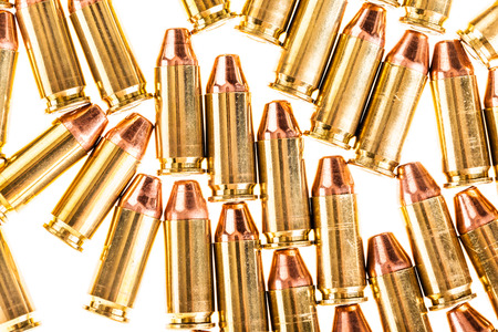 9mm: a bunch of 9mm handgun bullets cartridges isolated over a white background