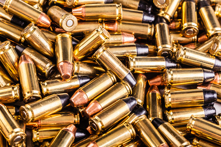 9mm ammo: close up shot of a heap of 9x21 pistol bullets