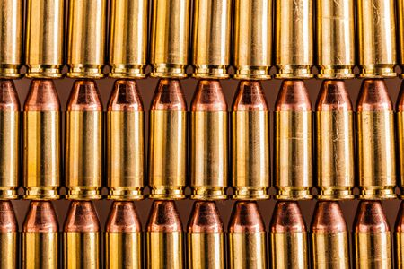 a lot of 9mm handgun bullets arranged in rows