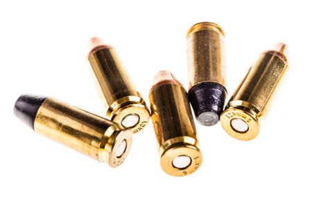 full jacket bullet: a bunch of 9mm handgun bullets cartridges isolated over a white background