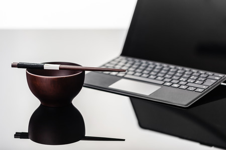 sleek: a modern, sleek and thin tablet with keyboard or laptop on a shiny surface