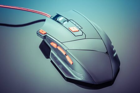 shiny buttons: a sleek modern gaming mouse with red buttons over a dark shiny surface Stock Photo