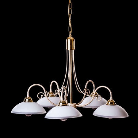 chandelier isolated: an old and simple chandelier isolated over a black background Stock Photo