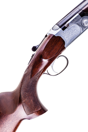 gatillo: detail of the trigger of a shotgun isolated over a white background