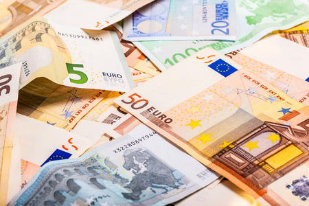spreaded: a heap of different denominations euros spreaded on a table