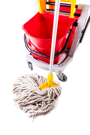 chores: a professional mop bucket cart isolated over a white background Stock Photo