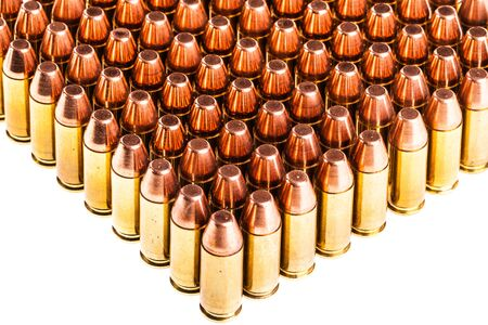 projectile: a lot of 9mm handgun bullets geometrically placed in rows isolated over a white background