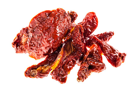 a heap of dried tomatoes isolated over a white background