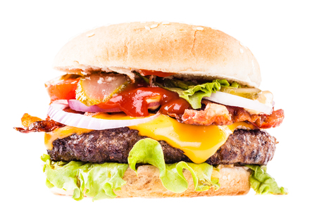 a big and tasty bacon cheeseburger isolated over a white background Foto de archivo