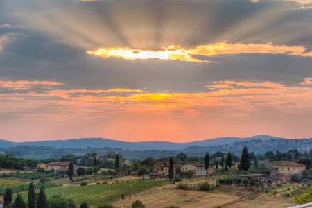 a majestic sunset in a rural zone of tuscany with vibrant colors