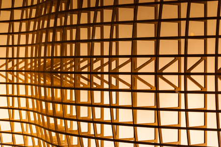 architectural detail of a wooden structure illuminated by a warm light Banco de Imagens