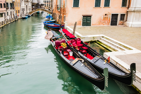 a beautiful Gondola on the canal in veince italy. Banco de Imagens