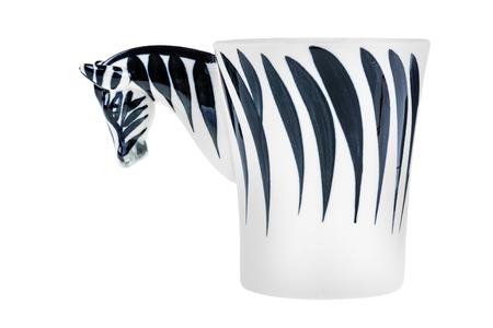 a zebra shaped mug isolated over a white background
