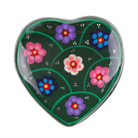 a heart shaped ceramic box isolated over a white background