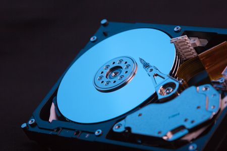 an opened hard disk on black background Banco de Imagens - 118799602