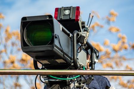 a professional studio tv camera user in outdoor events Banco de Imagens
