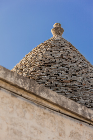 Ancient residential structures known as Trulli, found in Alberobello, in the south of italy Banco de Imagens