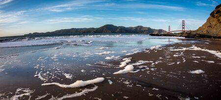 wide  wet: View of the Golden Gate Bridge from Bakers Beach in a sunny day