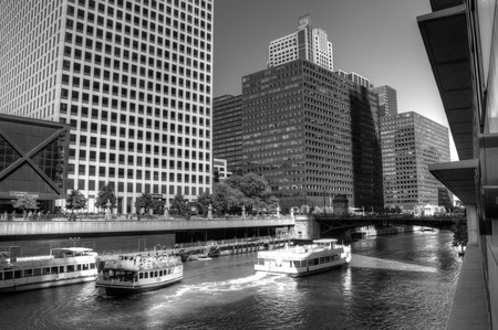 tour boats: View of two tour boats in the River around the downtown area of Chicago, IL Stock Photo