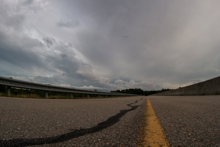 no pase: Storm at the distance, with deserted road in the foreground