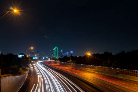 Multiple Lanes Highway Leading into Downtown Dallas Skyline