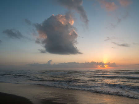 Large Gray Cloud on the Sky During Beach Sunrise