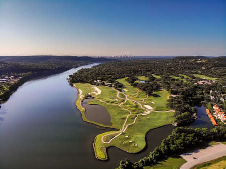 View of Golf Course From the Air With Downtown Austin in the Background 写真素材