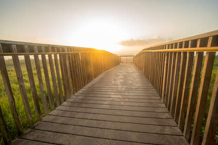 Low Angle View of Sunrise On the Horizon from Beach Board Walk