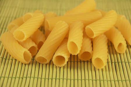 dry provisions: macaroni on bamboo Stock Photo
