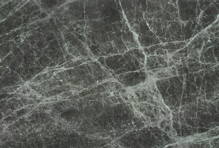 granite wall: black emberador marble with thin white veins