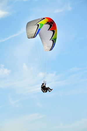 extreme sports: Paraglider flying in summer day