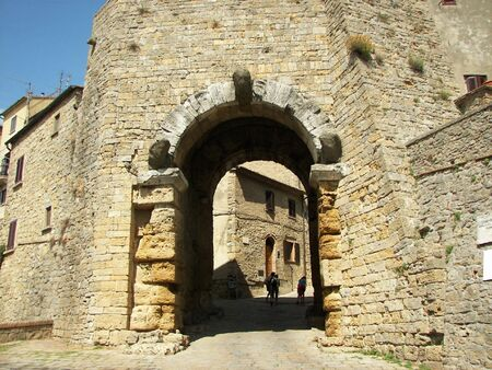 The old Volterra gate a nice Tuscany town from Italy photo