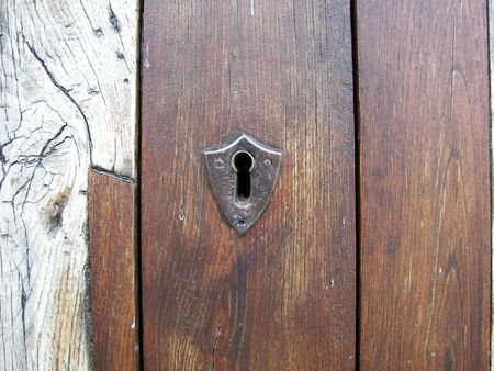 pieces of furniture: lock on the old wooden door Stock Photo