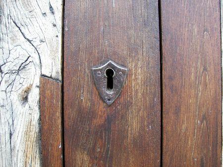 unmarried: lock on the old wooden door Stock Photo