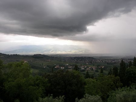 arcane: Incoming storm over the Florece valley from Tuscany Central Italy