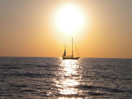 The sun sets the sea in a summer evening