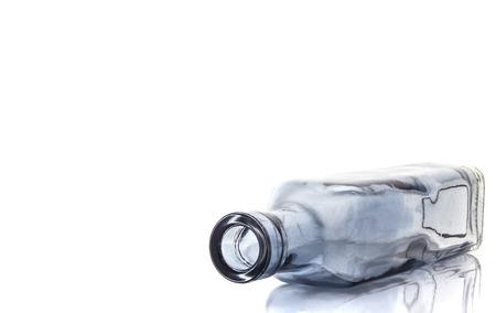 vodka bottle: Empty transparent glass bottle isolated on a white background Stock Photo