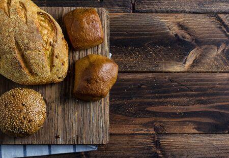 life loaf: loaf of bread on wooden background