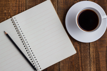 notebook pencil and cup of coffee on wood table 版權商用圖片
