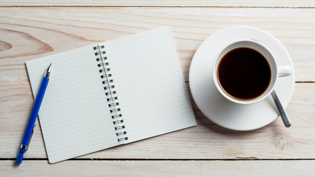 mug of coffee: Office desk table with supplies and coffee cup. Top view with copy space